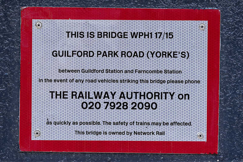 """Network Rail list this bridge as """"Yorke's Bridge"""", others dispute this, and refer to it as """"Yorkie's Bridge"""". This is the bridge that overlooks Guildford Station, from the London side. So, apart from the spelling mistake, this bridge is clearly not between Guildford and Farncombe staions."""