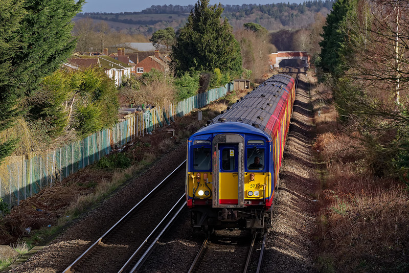 455 units don't normally travel further out than Guildford. On 1st February 2020, 455919 and 455871 did a full days diagram, working Waterloo to Haslemere. They are shown here approaching Farncombe with the 10:15 service from Waterloo.