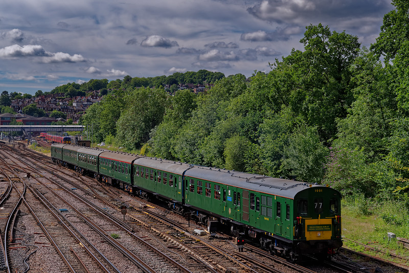 "Hasting Diesels DEMU 1001 departs from Guildford with 1Z77, the 07:55 Hastings - Lydney Junction ""Dean Forest Foray"" railtour, on 6th July 2019."