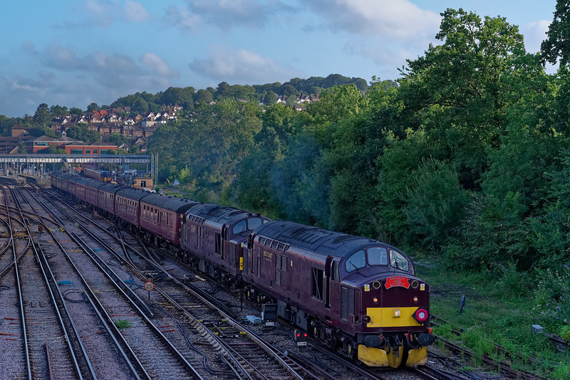 37706 / 37669 top & tailed with 37518 depart Guildford with 1Z77, the 19:05 Portsmouth Harbour - Crewe. The tour was organised by the Branch Line Society on 10th August 2019.