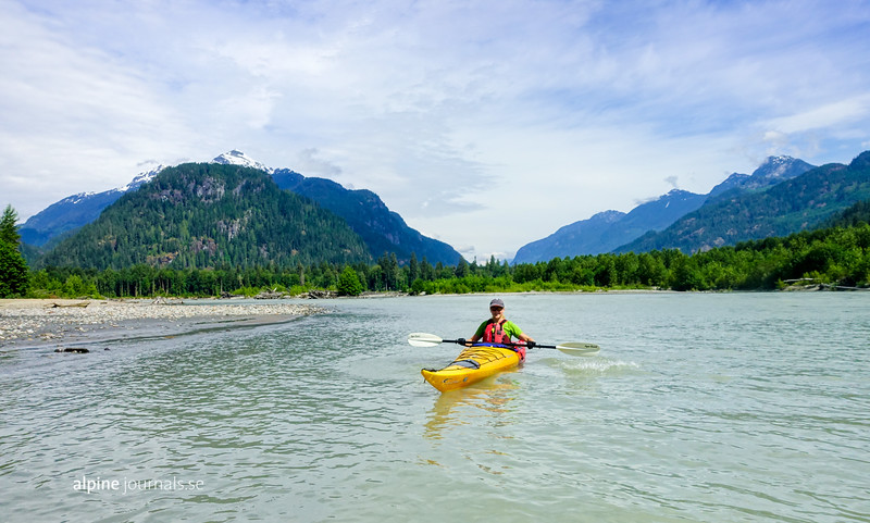 Kayaking in grand scenery along Squamish River. In some  sections the river is placid and gentle - elsewhere gushing and adventurous. Not for beginners, but if you feel prepared, enjoy the ride!