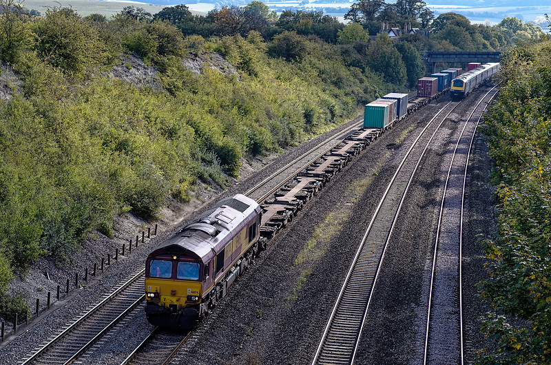 Viewed from the occupation bridge, 66174 approaches the station with 4M66, the 09:32 Southampton West Docks - Birch Coppice Intermodal service, on 13th October 2011.