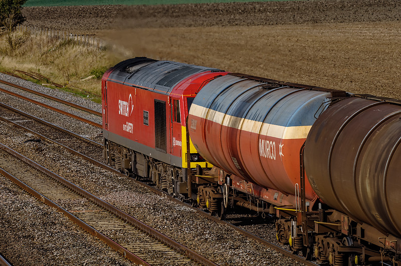 60007 going away from Manor Farm Bridge with 6B33, the 13:35 Theale Murco - Robeston Sidings, on 13th October 2011.