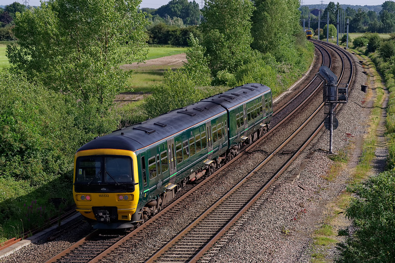 165133 heads north with the 08:44 Didcot Prkway - Banbury on 28th June 2019.