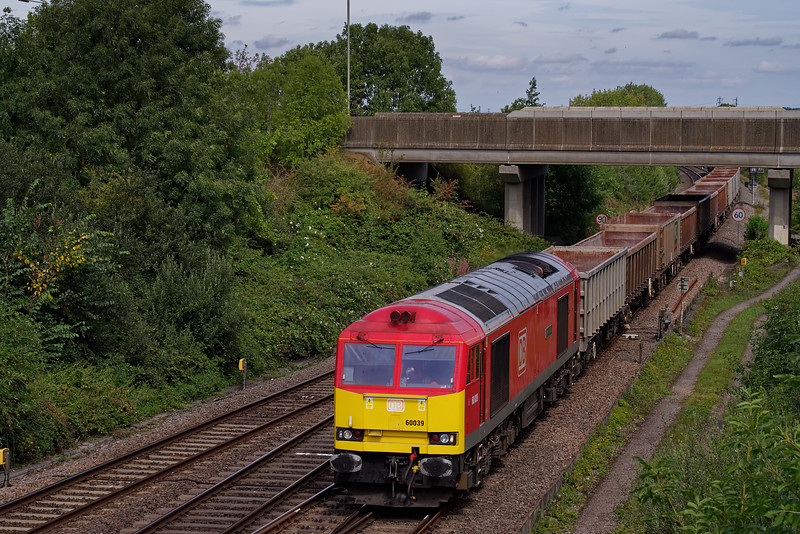 60039 with 6C58, the 11:45 Oxford Banbury Road - Whatley Quarry, stone empties. 30th August 2019.