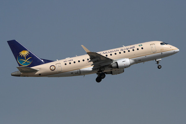 HZ-AED - Saudia -Saudi Arabian Airlines, Embraer ERJ-170LR (c/n 17000119)  Captured climbing away from Runway 12R at Dubai, with the airline's 60 years commemorative logo. 15 November 2009