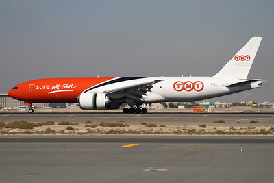 Reg: OO-TSA Operator: TNT Airways Type:  Boeing 777-FHT		   C/n: 38969 / 947   TNT's first Triple-Seven freighter seen with thrust reversers deployed on the landing roll-out in Dubai, operating a  service for Emirates SkyCargo     Photo Date: 14 November 2011 Photo ID: 1200440