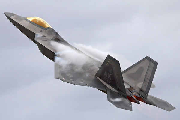 Reg: 06-4126 Code: AK Operator: USA - United States Air Force Type:  Lockheed Martin F-22A Raptor C/n: 645-4126   An Elmendorf based Raptor taking-off into a practice display in the lead up top the 2010 Royal International Air Tattoo at RAF Fairford, creating plenty of vapour in the moist air.     Photo Date: 16 July 2010 Photo ID: 1200410