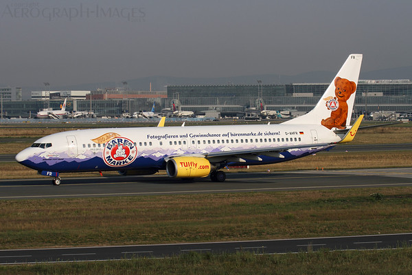 Reg: D-AHFR Operator: TUIfly Type:   Boeing 737-8K5/W C/n: 30593 / 528 Location:  Frankfurt-am-Main (FRA / EDDF), Germany   Taking the southern taxiway to runway 18 for departure, TUIfly have painted this 737 in a promotional Baren Marke livery to celebrate 100 years of the milk products company     Photo Date: 30 August 2013 Photo ID: 1300804
