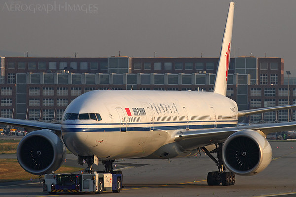 Reg:  B-2085Operator:  Air ChinaType:  Boeing 777-39LER  C/n:  38666 / 943Location:  Frankfurt-am-Main (FRA / EDDF), GermanyBeing towed to the remote parking area after its early morning arrival from Beijing Photo Date:  30 August 2013 Photo ID:  1300863