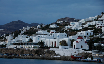 Mykonos Chora, the islands capital, owes its special character to the whitewashed, cubic shaped houses trimmed in every shade of blue, lining its narrow cobblestone streets.