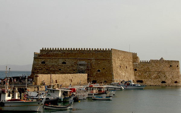 """Herkalion - Crete<br /> """"Venetian Fortress""""<br /> The island of Crete is the Mediterranean's fourth and Greece's largest island.  Herkalion, with a population of over 100,000 is the usual stating point for an exploration of the fabulous Minoan palaces.  The fame of the city as a centre of arts and culture under the Venetial rulers, gave its name to the island that in the medieval times was known as Candia.  The Venetian Walls of Heraklion, with a length of 4 kilometers and seven ramparts still standing today, are the most important fortifications in Greece."""