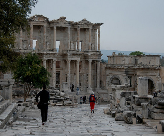 """Turkey - Ancient city of Epheses<br /> """"Celsus Library""""<br /> The library was built in 117 AD as a monumental tomb for Gaius Julius Celsus Polemaeanus, the governor of the province of Asia, from his son Galius Julius Aquila.  The grave of Celsus was beneath the ground floor, across the entrance and there was a statue of Athena over it because Athena was the goddess of wisdom.  Scrolls of manuscripts were kept in cupboards in niches on the walls.  There were double walls behind the bookcases to prevent them from the extremes of temperature and humidity.  The capacity of the library was more than 12,000 scrolls.  It was the third richest library in ancient times after the Alexandra and Pergamum.  The facade of the library has two stories, with Corinthian style columns on the ground floor and three entrances to the building.  There was also an auditorium which was for lectures or presentations."""