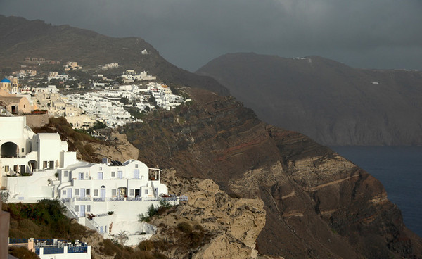 Santorini - Town of Oia<br /> Oia has preserved most of its character and its peacefulness.  Its white houses, built virtually on top of each other, appear to hang on to the cliff; some of them are even built into it.