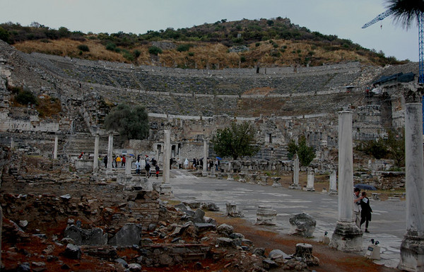 """Turkey - Ancient city of Epheses<br /> """"The Great Theatre""""<br /> The theatre was first constructed in the Hellenistic Period, the third century BC during the reign of Lysimachos, but then during the Roman Period it was enlarged and formed its current style that is seen today.  It is the largest in Anatolia and has the capacity of 25,000 seats.  The cavea has sixty-six rows of seats, divided by two diazoma (walkway between seats) into three horizontal sections.  There are three sections of seats.  In the lower section, Marble pieces, used for restoration, and the Emperor's Box were found.  The seats with backs, made of marble, were reserved for important people.  The audience entered from the upper cavea.  The facade facing the audience was ornamented with reliefs, columns with niches, windows and statues.  There are  five doors opening to the orchestra area, the middle one of which is wider than the rest.  This enhanced the appearance of the stage, giving it a bigger, monumental look.  The theatre was used not only for concerts and plays, but also for religious, political and philosophical discussions and for gladiator and animal fights."""