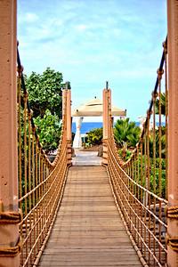 Rope bridge across the large pool at the Lagoon Tower, Hilton Waikoloa Village