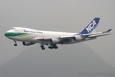 "Reg:  JA04KZOperator:  Nippon Cargo AirlinesType:  Boeing 747-4KZF  C/n:  34283 / 1384Location:  Hong Kong - Chek Lap Kok (HKG / VHHH), China""NCA Pegasus"" on short finals to runway 07R on a murky day at Chek Lap Kok Photo Date:  12 March 2012Photo ID:  1300880"