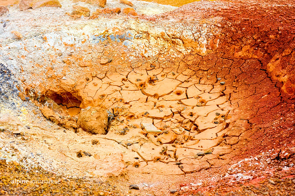 A dry mud poool with Incredible colors from minerals such as sulphur compounds and oxidated iron. At Krýsuvik on the Reykjanes peninsula.