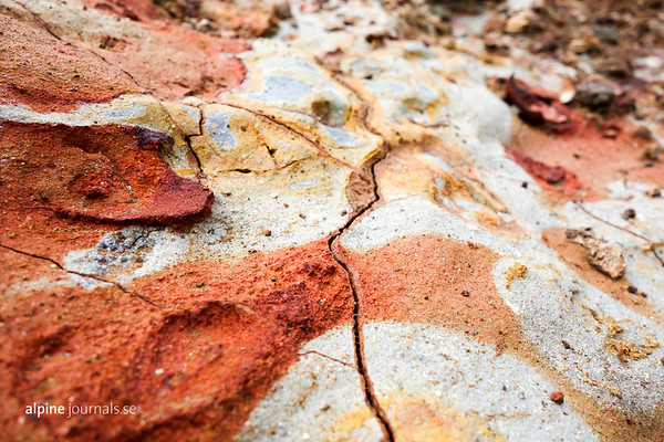 Mineral deposits from geothermal activity, coming togeher into a naturla work of art.