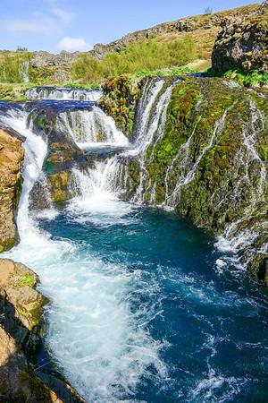 Trickling waterfalls in Gjáin canyon, Þjórsárdalur.