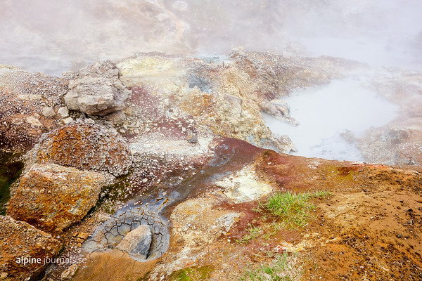 Mud pots and mineral rich ground in the incredible Klambragil gorge. Bubbling with geothermal activity, sparkling with color, and surrounded by moody raw cliffs hiding a beautiful little waterfall, this is a definite favourite - be sure to add this short extra hike to the end of Reykjadalsá if you are in the area!