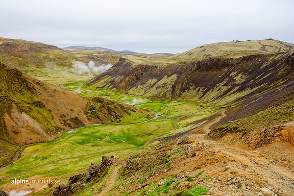 A path climbs over Klambragil, overlooking the upper part of Reykjadalsá in the Hengill geothermal area. The path leads past hot springs and mud pots over Ölkelduhnúkur, and decends on the western side of the mountain at Ölkelduháls near Thingvallavatn.