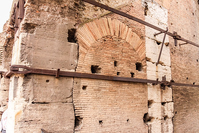 Iron Bars Supporting the Colosseum Stone Arches