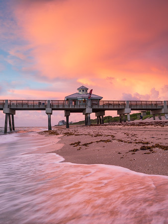 Storm clouds clearing at  the Juno Beach Pier