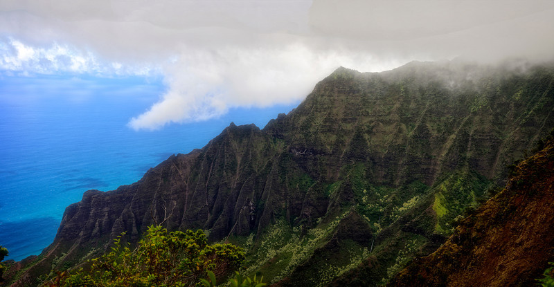 Pano Napili rugged mountain ridge shrouded in fog mist