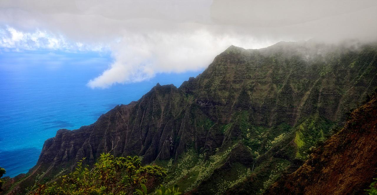 Pano Napili rugged mountain ridge shrouded in fog mist