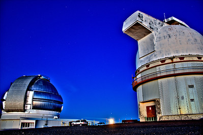 Keck Observatory on Hawaii's Big Island atop Mauna Kea - taken just just as the full moon rises between the two massive telescopes. You can see Jupiter just above the moon.