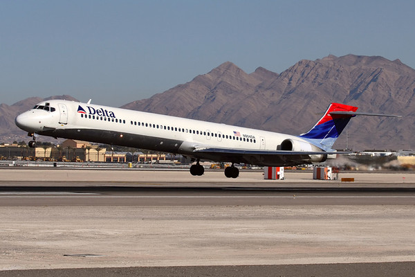 """Reg: N904DA Operator: Delta Air Lines Type:  McDonnell Douglas MD-90-30 C/n: 53384 / 2096   Delta Air Lines are one of very few MD-90 operators left in the world, and are acquiring second-hand airframes to grow their fleet. Here one of their original batch lands in Las Vegas in the """"wavy"""" colourscheme.     Photo Date: 20 January 2008 Photo ID: 1200374"""