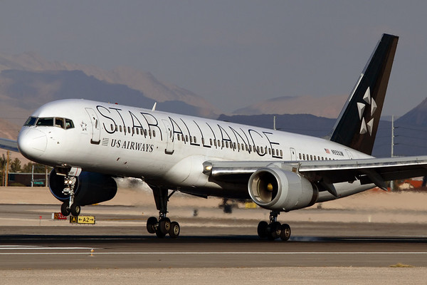 Reg: N933UW Operator: Star Alliance - US Airways Type:  Boeing 757-2B7W C/n: 33424 / 901   The main gear meets the tarmac of 25L at Las Vegas after the flight from Philadelphia. Since retired by US Airways and Transferred to FedEx in Canada as a freighter.     Photo Date: 21 January 2008 Photo ID: 1200389