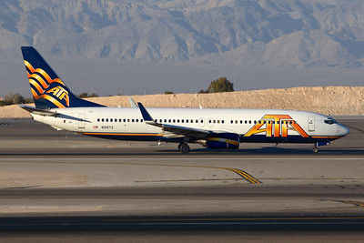 Reg: N319TZ Operator: ATA Airlines Type:  Boeing 737-83NW C/n: 30643 / 1106   ATA departure taxiing to runway 25R at Las Vegas-McCarran, in the later colours shortly before the airline ceased operations. This aircraft now serves Garuda Indonesia as PK-GEH     Photo Date: 20 January 2008 Photo ID: 1200375
