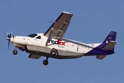 Reg: N763FE Operator: FedEx Feeder Type:  Cessna 208B Caravan C/n: 208B-0256   FedEx parcel feeder flight climbing away from Las Vegas     Photo Date: 21 January 2008 Photo ID: 1200384