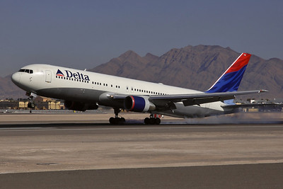 Reg: N139DL Operator: Delta Air Lines Type:  Boeing 767-332   C/n: 25984 / 427   Burning rubber on arrival into Las Vegas' runway 25L.     Photo Date: 19 January 2008 Photo ID: 1200012
