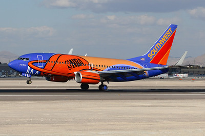 Reg: N224WN Operator: Southwest Airlines Type:  Boeing 737-7H4W		   C/n: 32493 / 1801   Slam Dunk One touching down on Las Vegas-McCarran's runway 25R     Photo Date: 21 January 2008 Photo ID: 1200379