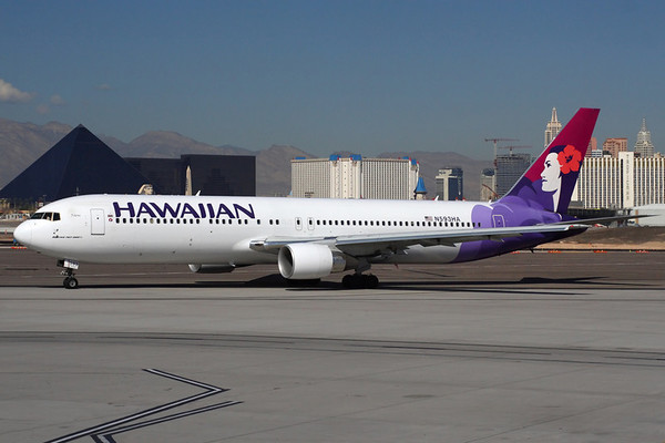 Reg: N593HA Operator: Hawaiian Airlines Type:  Boeing 767-33AER C/n: 33424 / 901   Taxiing for departure at KLAS with the unmistakeable skyline of the Las Vegas strip behind. This 767 now flies with Air Canada, having been replaced at Hawaiian by the arrival of their A.330s.     Photo Date: 07 October 2006 Photo ID: 1200378