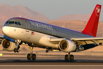 N376NW - Northwest Airlines, Airbus A.320-212 (c/n 1812)  Northwest A320 flaring for landing in late afternoon sun at Las Vegas, now flying for Delta after the merger. 20 January 2008