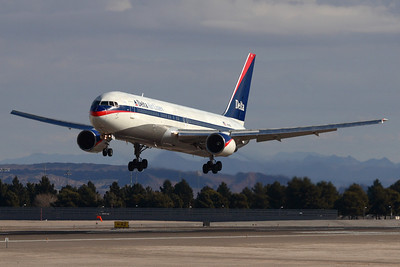 Reg: N130DL Operator: Delta Air Lines Type:  Boeing 767-322 C/n: 24080 / 130   Over the threshold of 25L at Las vegas-McCarran, wearing Delta's interim colourscheme of the mid 2000s.     Photo Date: 21 January 2008 Photo ID: 1200390