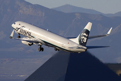 Reg: N552AS Operator: Alaska Airlines Type:  Boeing 737-890W C/n: 34595 / 1882   An  Alaska 737-800 climbs away from runway 25R at Las Vegas, against the back drop of the Luxor Casino hotel and the Nevada mountains.     Photo Date: 21 January 2008 Photo ID: 1200385