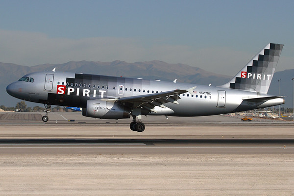 """N527NK - Spirit Airlines, Airbus A.319-132 (c/n 2978)  Spirit Airbus performing an early morning landing on 25L at Las Vegas, in the former """"digital"""" colour-scheme. 20 January 2008"""