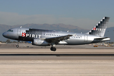 "N527NK - Spirit Airlines, Airbus A.319-132 (c/n 2978)  Spirit Airbus performing an early morning landing on 25L at Las Vegas, in the former ""digital"" colour-scheme. 20 January 2008"