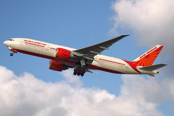 Reg: VT-ALD Operator: Air India  Type:  Boeing 777-237LR		   C/n: 36303 / 663 Location:  London - Heathrow (LHR / EGLL) - UK   The raked wingtips of the 777-200LR series are well illustrated on this Air India departure to Delhi Indira Ghandi International, the sun deciding to go behind a cloud at just the wrong moment.     Photo Date: 14 March 2013 Photo ID: 1300618