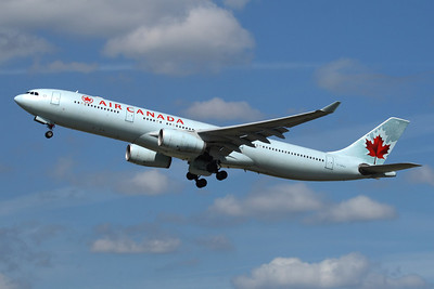 "Reg: C-GFAJ (933) Operator: Air Canada Type:  Airbus A.330-343X C/n: 284   ""Air Canada 851"" departs London-Heathrow for the North Atlantic crossing to Calgary.     Photo Date: 23 August 2009 Photo ID: 1200451"