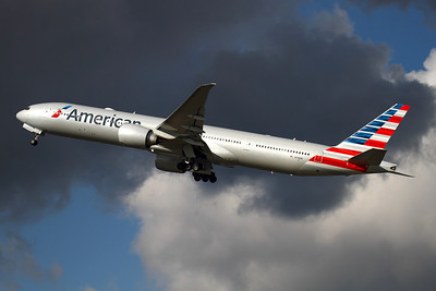 """Reg: N718AN Operator: American Airlines Type:  Boeing 777-323ER C/n: 41665 / 1062 Location:  London - Heathrow (LHR / EGLL) - UK   Wearing the stylish new scheme, """"American 79"""" climbs into threatening skies above London-Heathrow     Photo Date: 14 March 2013 Photo ID: 1300718"""