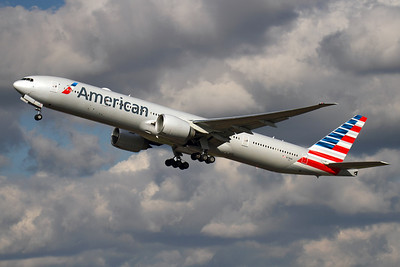 """Reg: N718AN Operator: American Airlines Type:  Boeing 777-323ER C/n: 41665 / 1062 Location:  London - Heathrow (LHR / EGLL) - UK   """"American 79"""" climbs away from runway 27L at the start of its journey to Dallas-Fort Worth - looking resplendent in American's stunning new livery.     Photo Date: 14 March 2013 Photo ID: 1300606"""