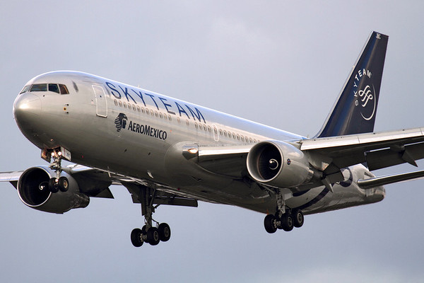 """Reg: XA-JBC Operator: Skyteam - Aeromexico Type:  Boeing 767-284ER C/n: 24762 / 307 Location:  London - Heathrow (LHR / EGLL) - UK   """"Aeromexico 7"""" on final approach to 27L in a gloomy spell in West London. 'BC wears the Skyteam alliance livery, which Aeromexico have been a founder member of since 2000.     Photo Date: 14 March 2013 Photo ID: 1300609"""