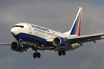 Reg: EI-EUW Operator: Transaero Airlines Type:  Boeing 737-7Q8 C/n: 29350 / 1452 Location:  London - Heathrow (LHR / EGLL) - UK   Former Malev Boeing 737 on short finals to runway 27L, arrving from Moscow-Domododevo     Photo Date: 14 March 2013 Photo ID: 1300719