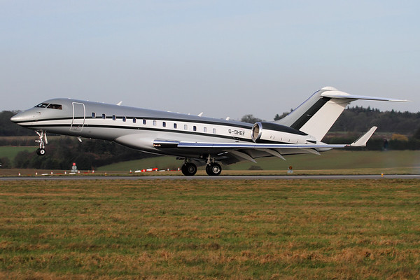 Reg: G-SHEF Type: Bombardier BD.700 Global Express XRS		   C/n: 9306   Very smart Global Express captured on touchdown on Luton's runway 26.     Photo Date: 24 Feb 2011 Photo ID: 1200006